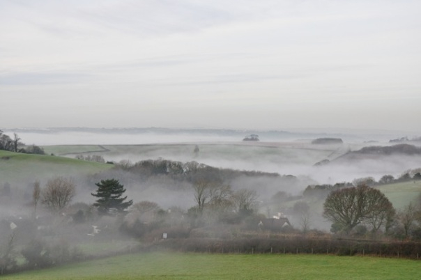 Mist_in_the_valley_of_St_John_and_Bodmin_in_the_distance